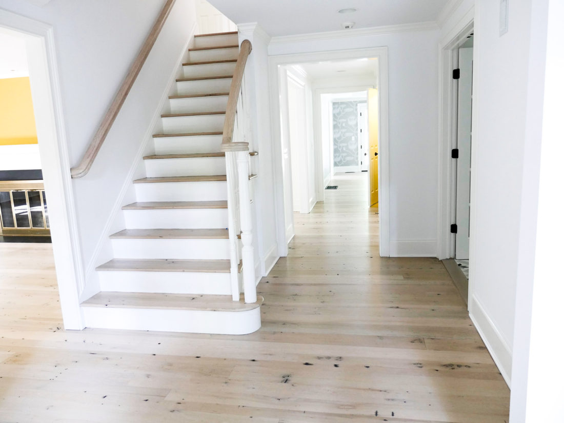 Freshly renovated home in Connecticut with light wood floors and white walls