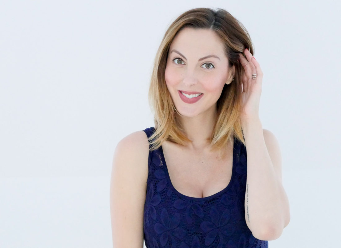 Eva Amurri Martino of Happily Eva After blog wearing a navy blue lace dress and showing off a makeup look created by using the products in her September Beauty Picks roundup