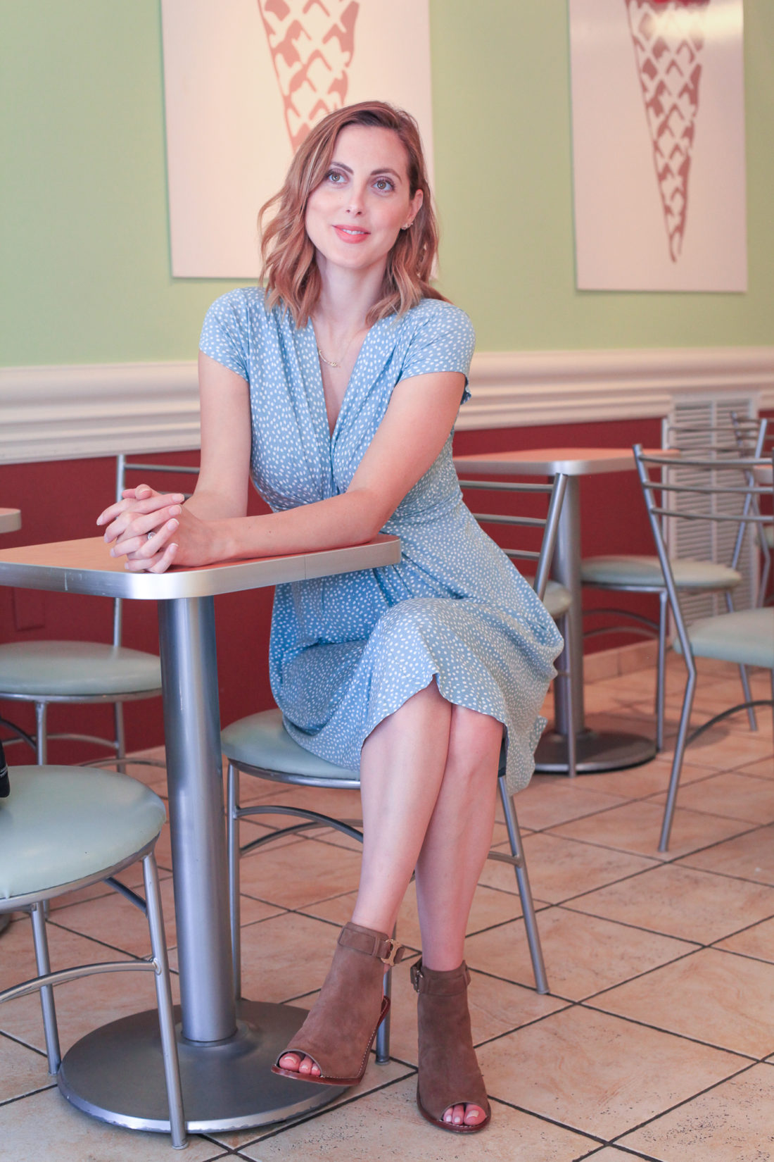 Eva Amurri Martino of Happily Eva After Blog wearing light blue Seraphine Maternity dress and tory burch booties
