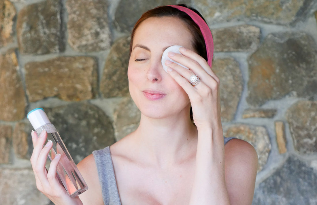 Eva Amurri Martino of lifestyle blog Happily Eva After removing her eye makeup with a cotton pad Vichy makeup remover