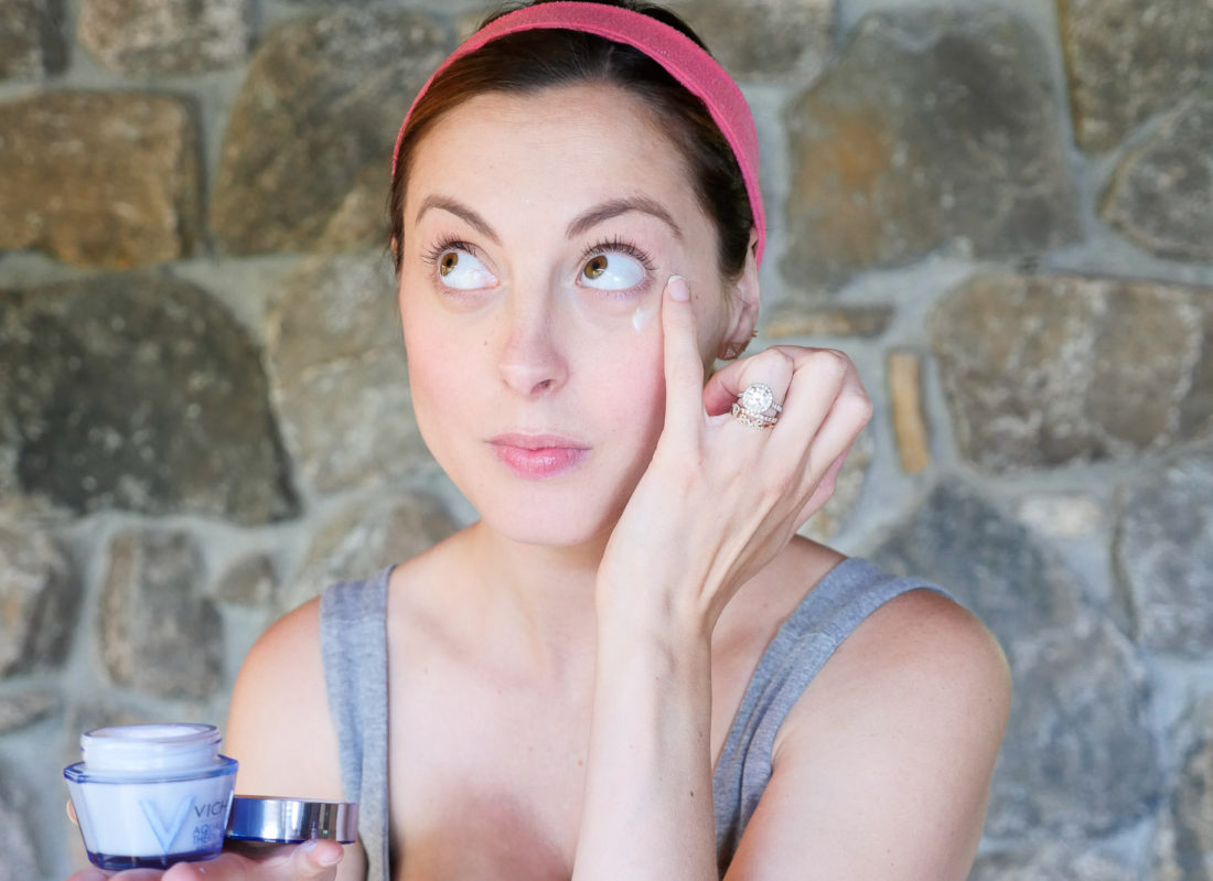 Eva Amurri Martino of lifestyle blog Happily Eva After applying undereye cream as she demonstrates how she preps her skin for Fall weather.