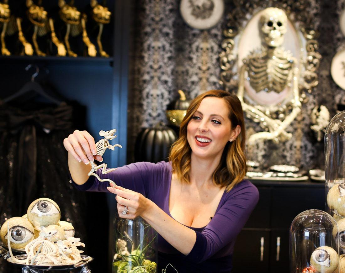 LIfestyle blogger Eva Amurri Martino of blog Happily Eva After creating a custom DIY spooky terrarium for halloween at the Grandin Road pop up shop at Macy's herald square