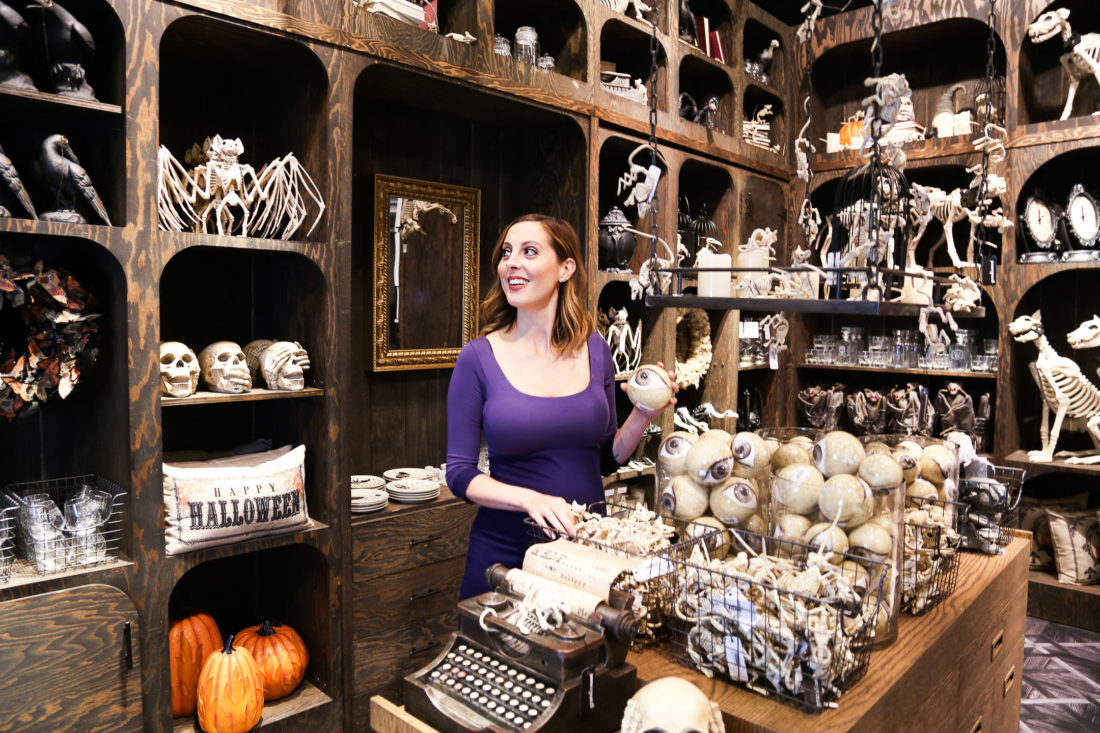 LIfestyle blogger Eva Amurri Martino of blog Happily Eva After creating a custom DIY spooky terrarium for halloween at the Grandin Road pop up shop at Macy's herald square