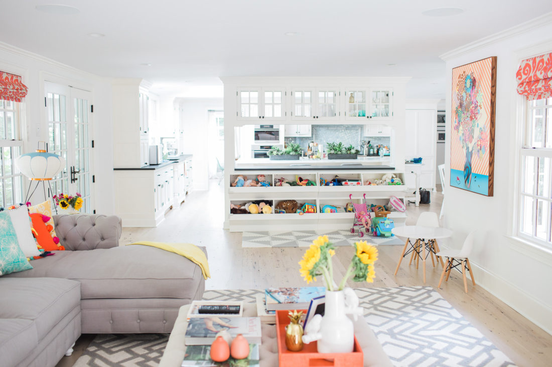 View of the custom play area of Eva Amurri Martino's family room in connecticut featuring built in toy storage and an open floor plan