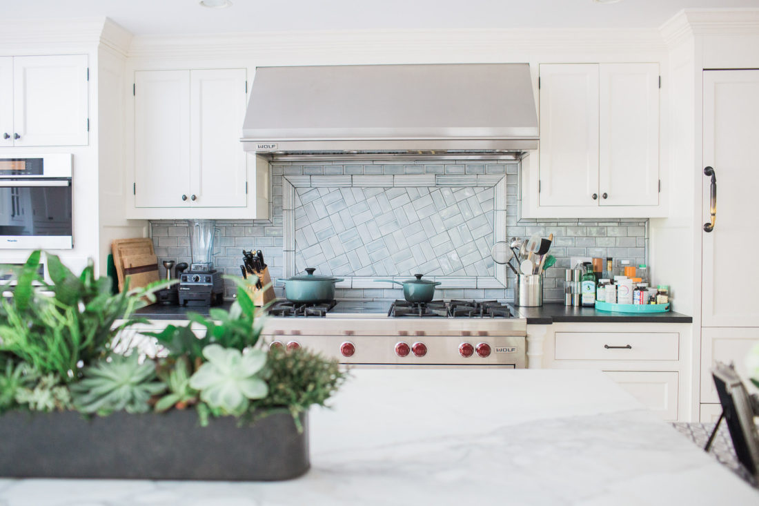 The stovetop range in the light and bright kitchen of lifestyle blogger Eva Amurri Martino in her new home in connecticut