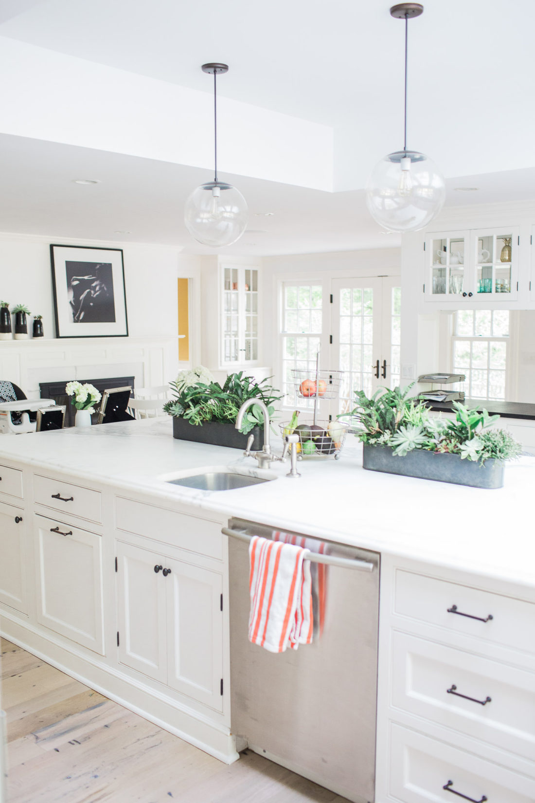 The light, bright, and white kitchen of Eva Amurri Martino in her new Connecticut Home.  Industrial accents and huge white marble kitchen island