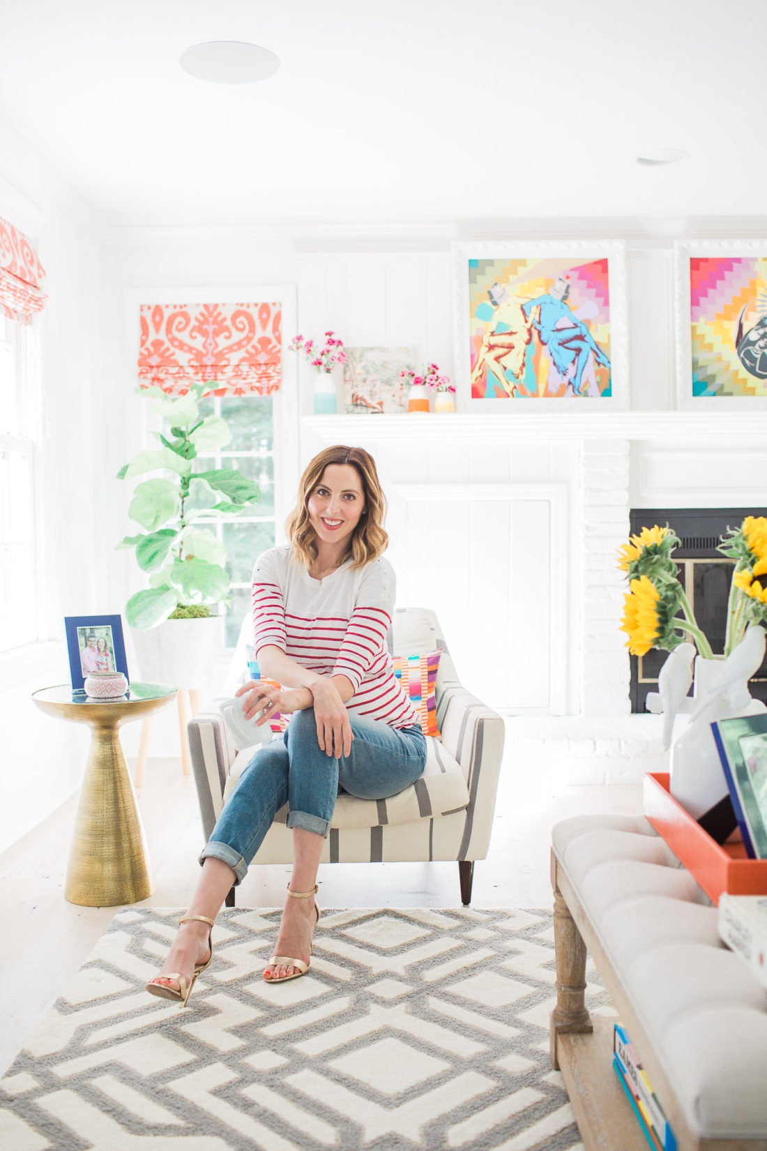 Eva Amurri Martino of Lifestyle Blog Happily Eva After sitting in a striped armchair in the corner of her family room in connecticut