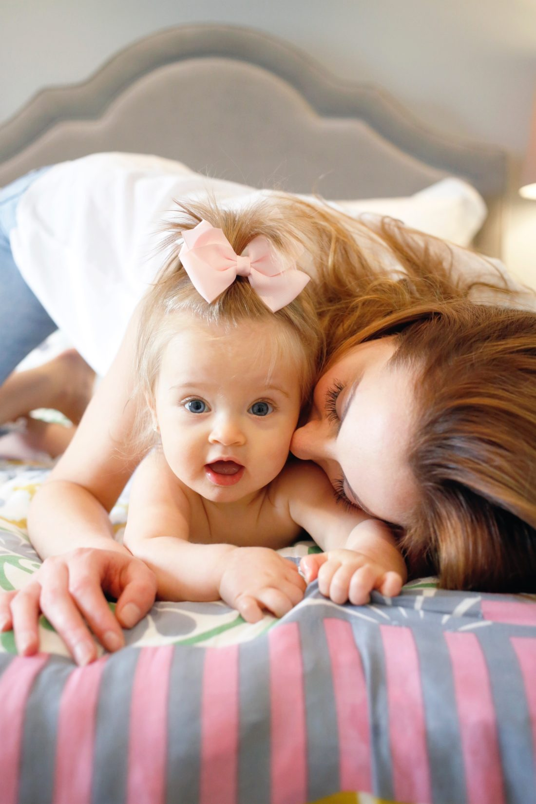 Eva Amurri Martino of Happily Eva After blog snuggling with her daughter Marlowe who wears her hair in a pink bow