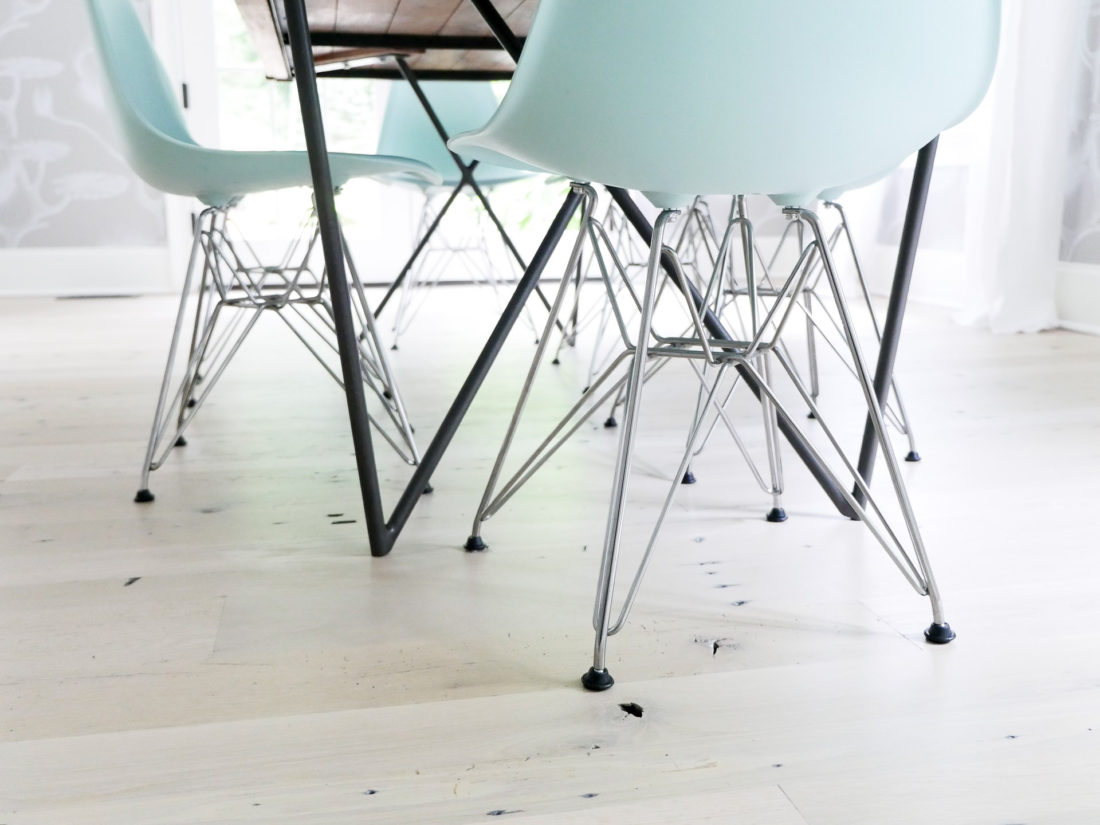 A detail shot of the robin's egg blue mid century modern eames molded chairs with an eiffel tower base featured in the dining room of Happily Eva After's Eva Amurri Martino