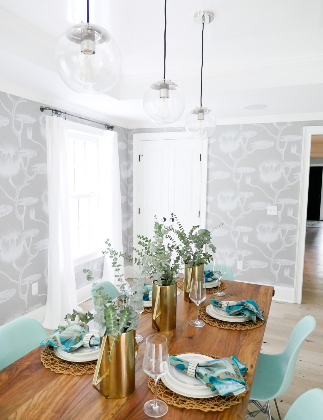 A shot of the fully set table in Eva Amurri Martino's bright and airy california-inspired dining room in connecticut