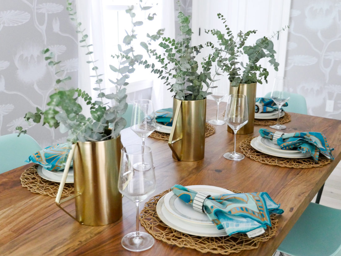 A shot of the fully set table in Eva Amurri Martino's dining room in connecticut, featuring a light and airy Californian vibe with industrial accents