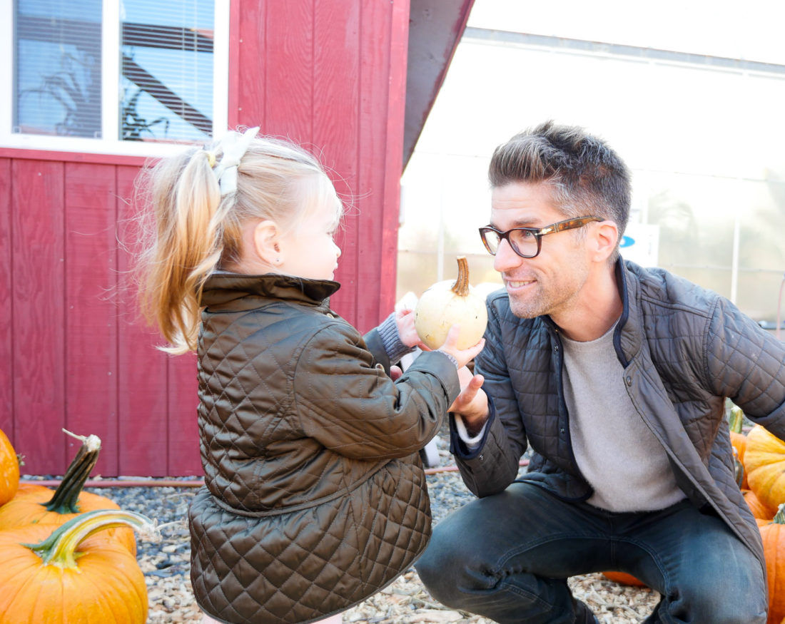 Kyle Martino picking out pumpkins with two year old daughter Marlowe at silverman's pumpkin patch in connecticut