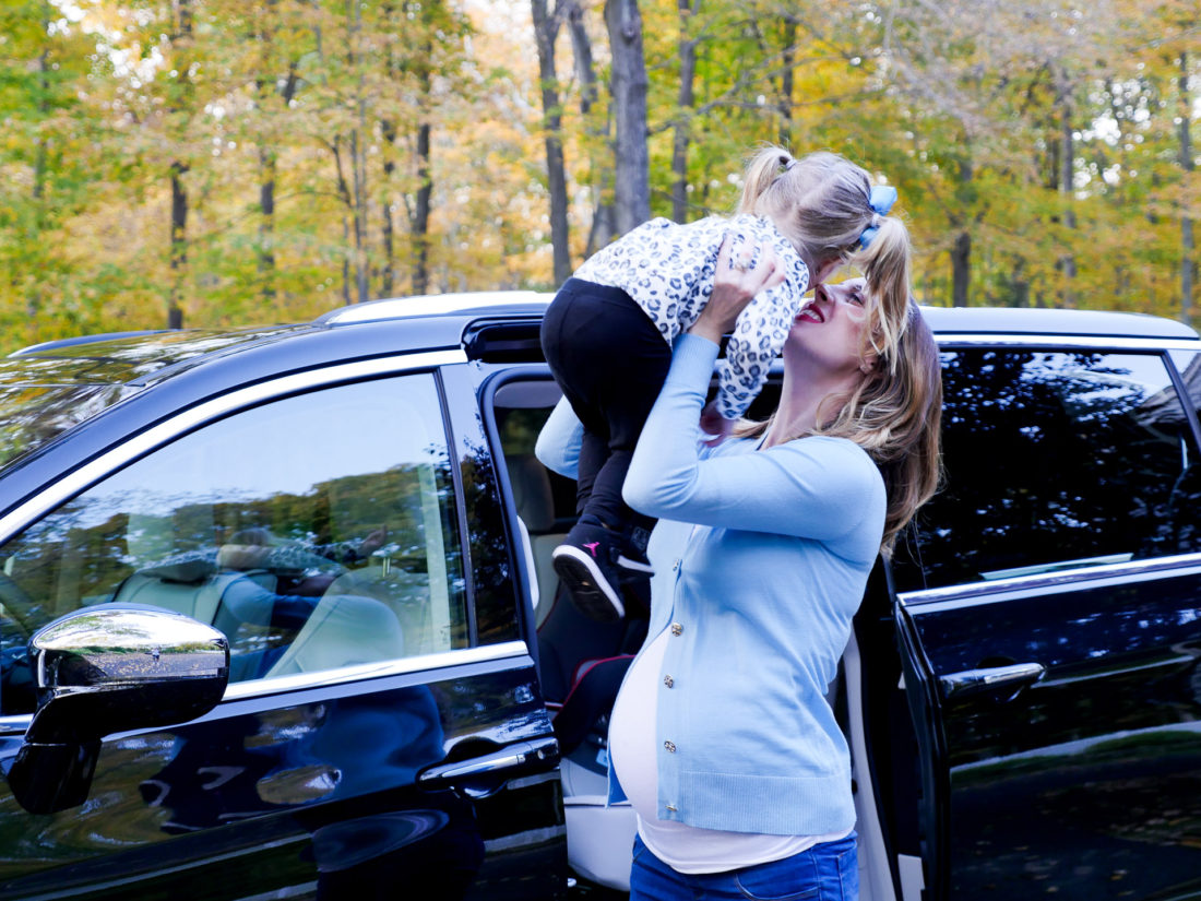 Eva Amurri Martino pictured at nine months pregnant, lifting daughter Marlowe in to the air