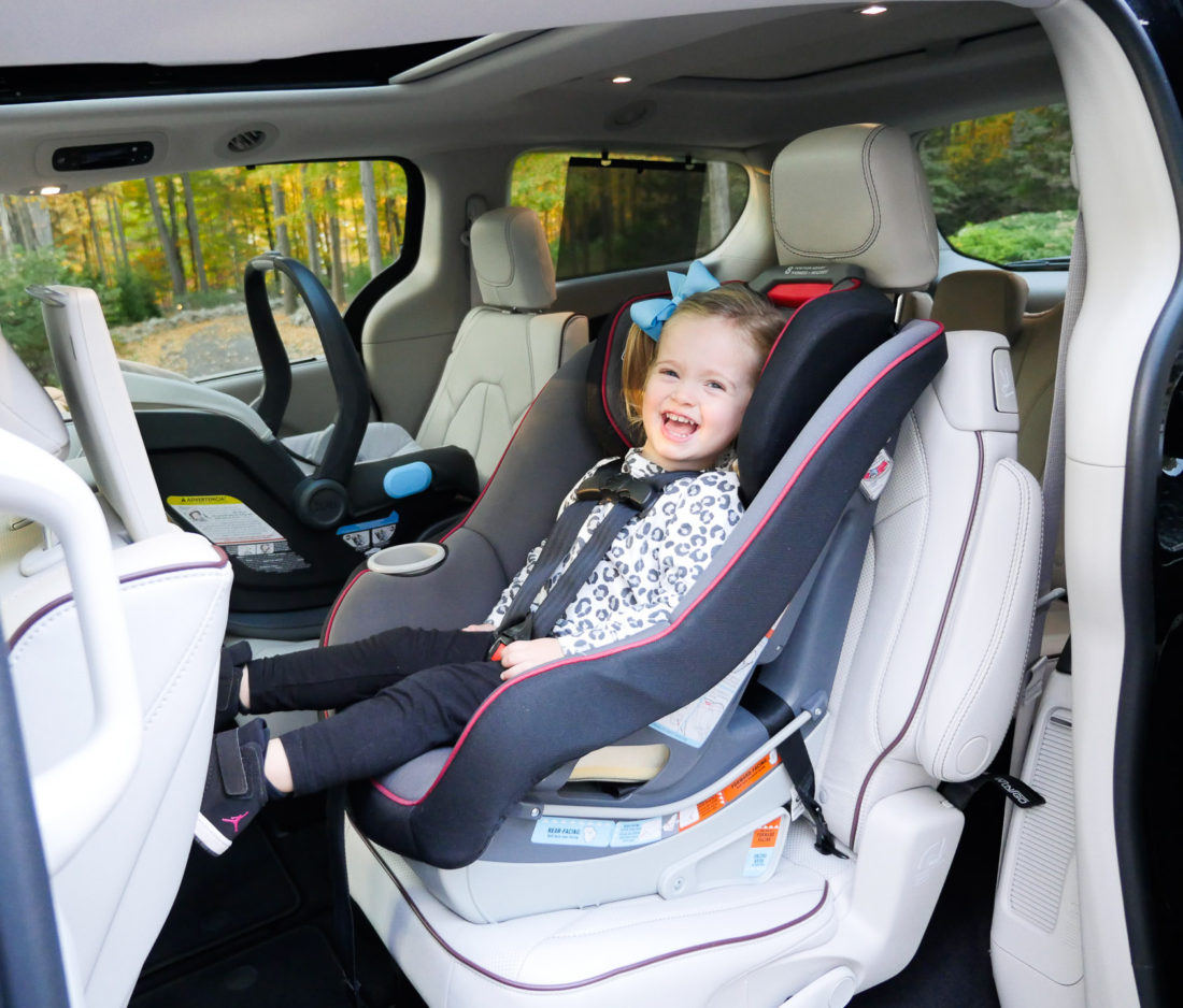 Marlowe Martino pictured sitting in a black chrysler pacifica