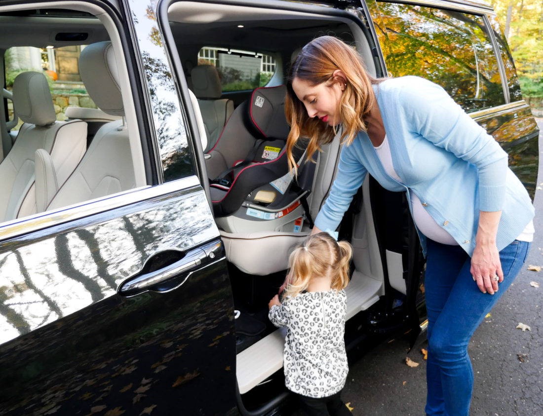 Eva Amurri Martino pictured using the attached vacuum cleaner in her new Chrysler Pacifica