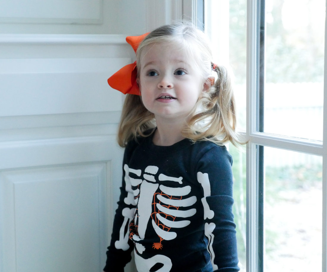 Marlowe Martino, wearing a skeleton costume and orange bow on Halloween