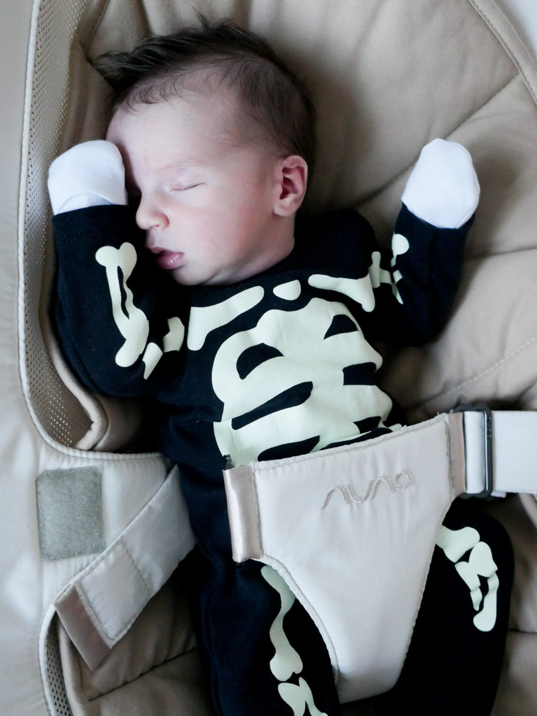 Major Martino, wearing a skeleton Halloween costume at one week old