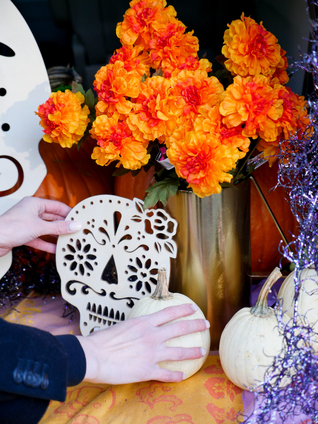 Eva Amurri Martino decorating her trunk with a Day Of The Dead theme for her daughter's Preschool's Trunk-or-Treat party