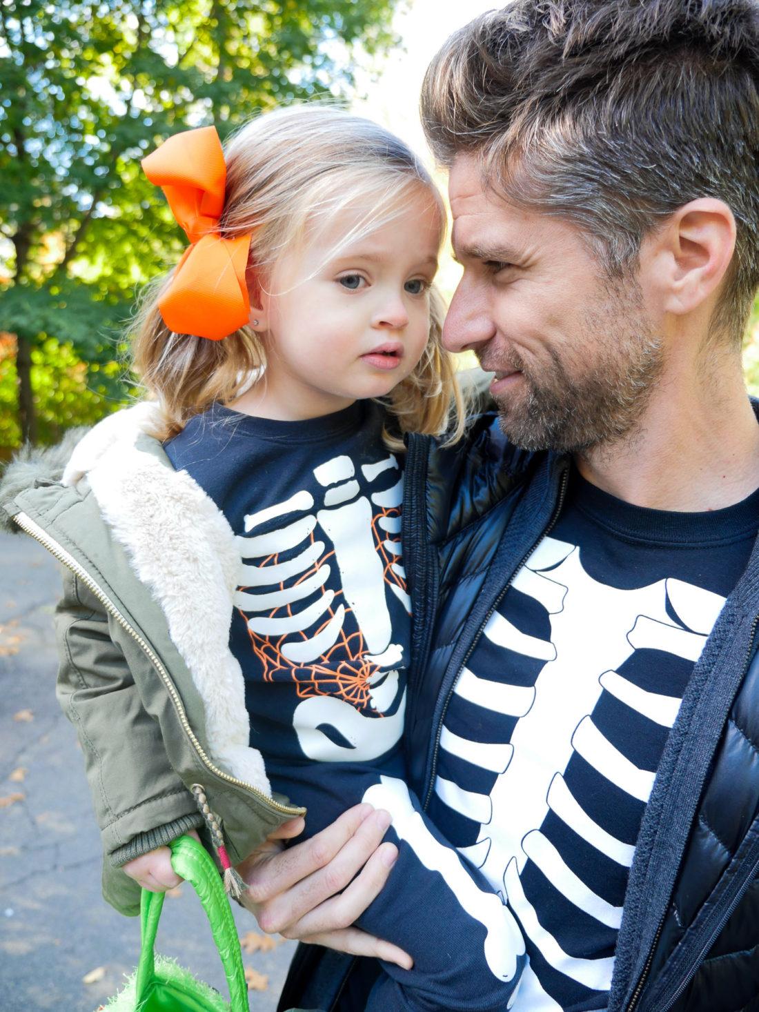 Kyle Martino and Marlowe Martino dressed up as skeletons on halloween