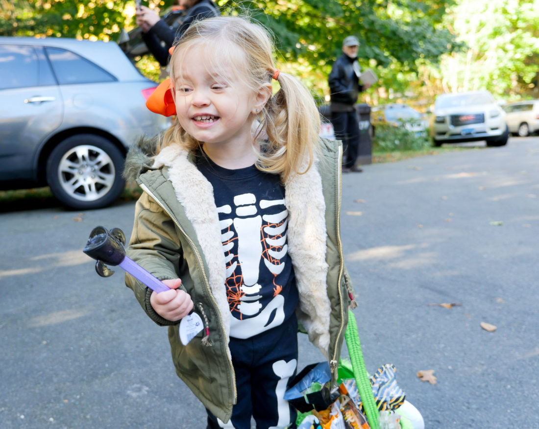 Marlowe Martino trick or treating in a skeleton costume on halloween