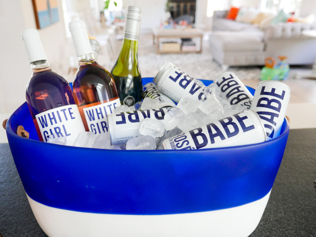 a blue and white resin bucket containg white girl rose and babe sparkling rose wine at Eva Amurri Martino's Sip and See for newborn son Major James
