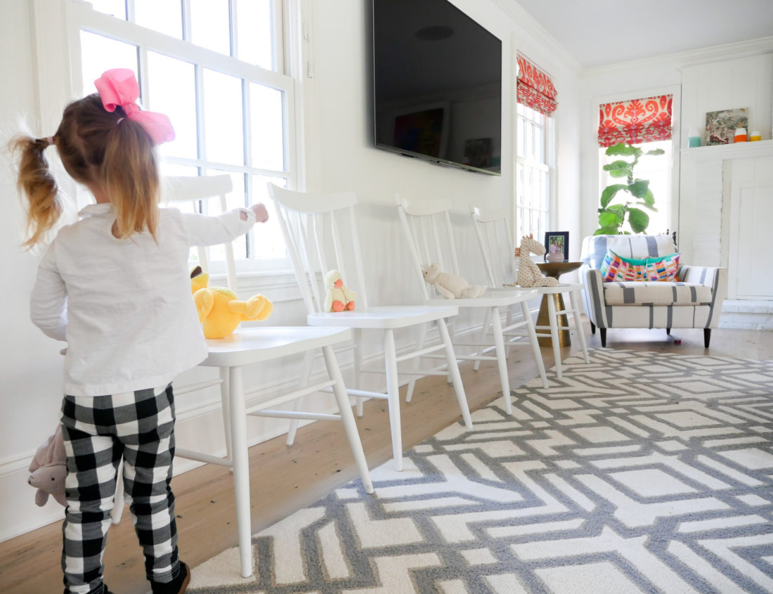 Marlowe Martino placing stuffed animals on chairs at her brother's Sip And See