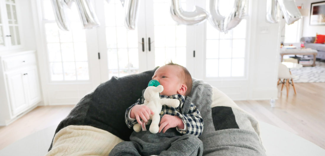 Lifestyle and Motherhood blogger Eva Amurri Martino's newborn son, Major James, is pictured in the foreground with a balloon sign spelling out his name at the Sip And See party in his honor at her connecticut home