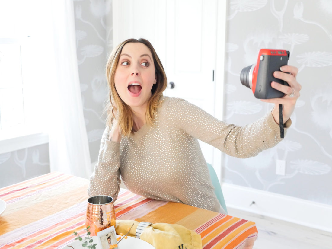 Eva Amurri Martino pictured taking a selfie with her red Instax mini 70 camera