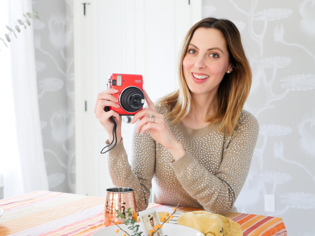 Eva Amurri Martino of lifestyle and Motherhood blog Happily Eva After demonstrates how to create holiday place card settings using the Instax mini 70 camera