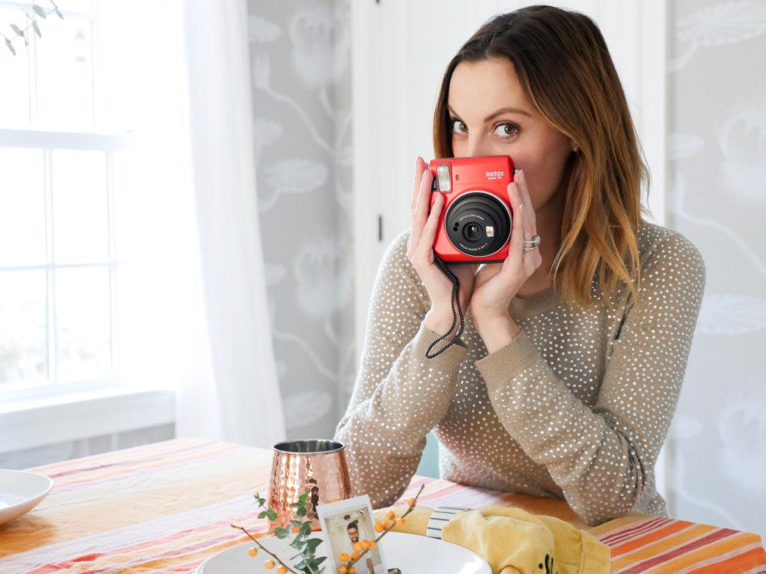 Eva Amurri Martino pictured with her red Instax mini 70 camera