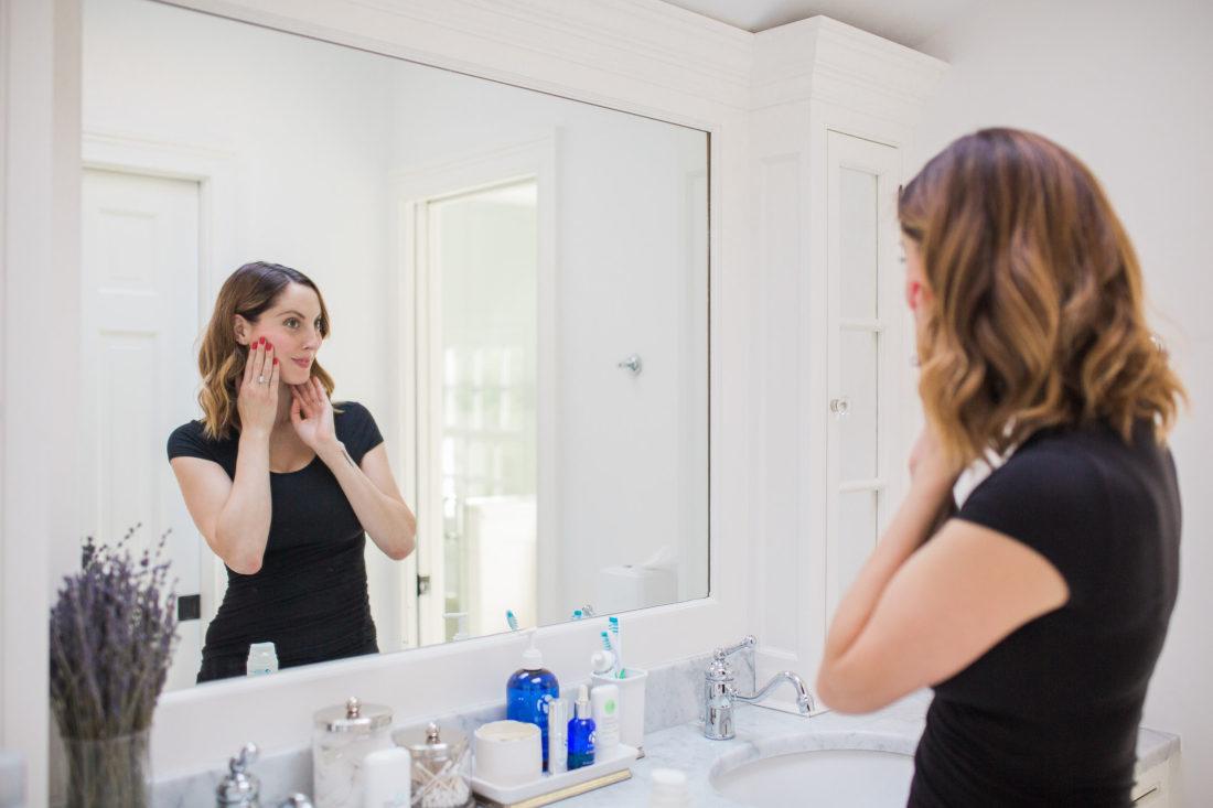 Eva Amurri Martino applying face cream in her bathroom in connecticut