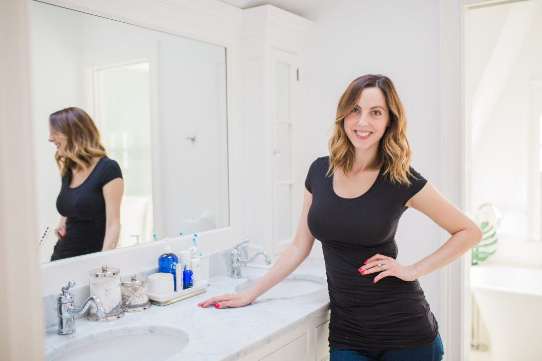 Eva Amurri Martino wearing a black tshirt posing in her master bathroom at her home in connecticut