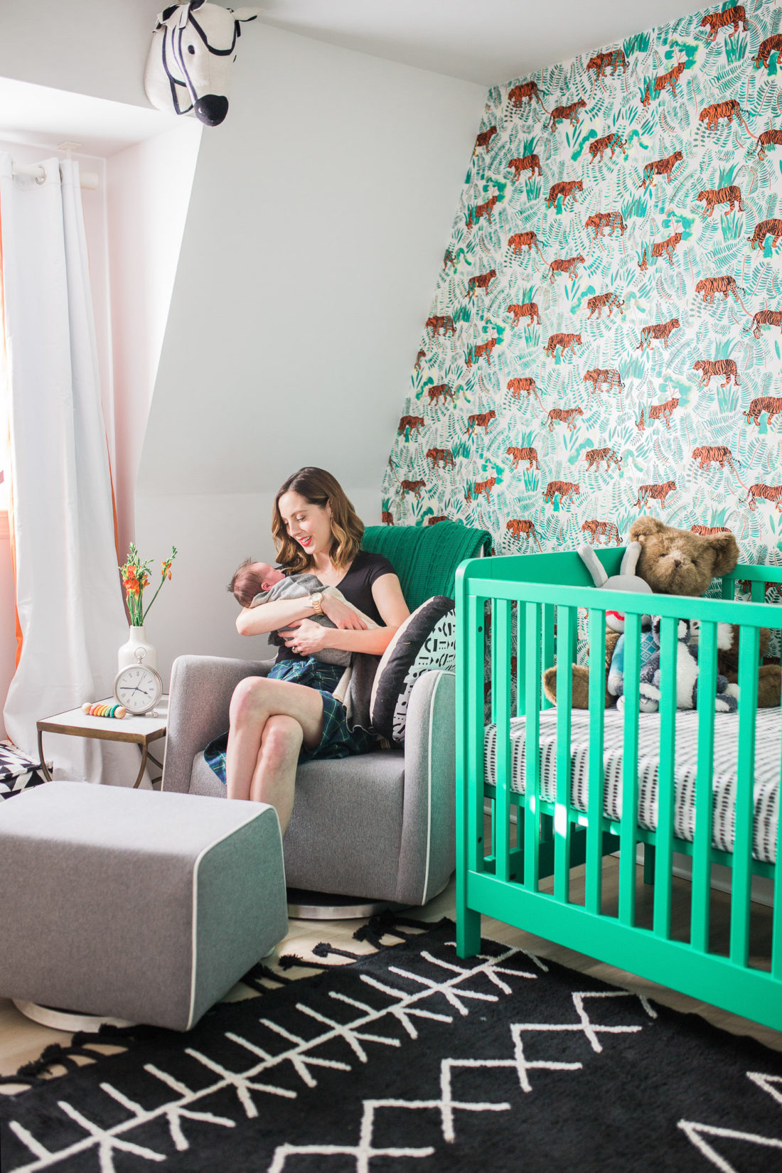 Eva Amurri Martino hold her newborn son Major in his graphic and bold nursery