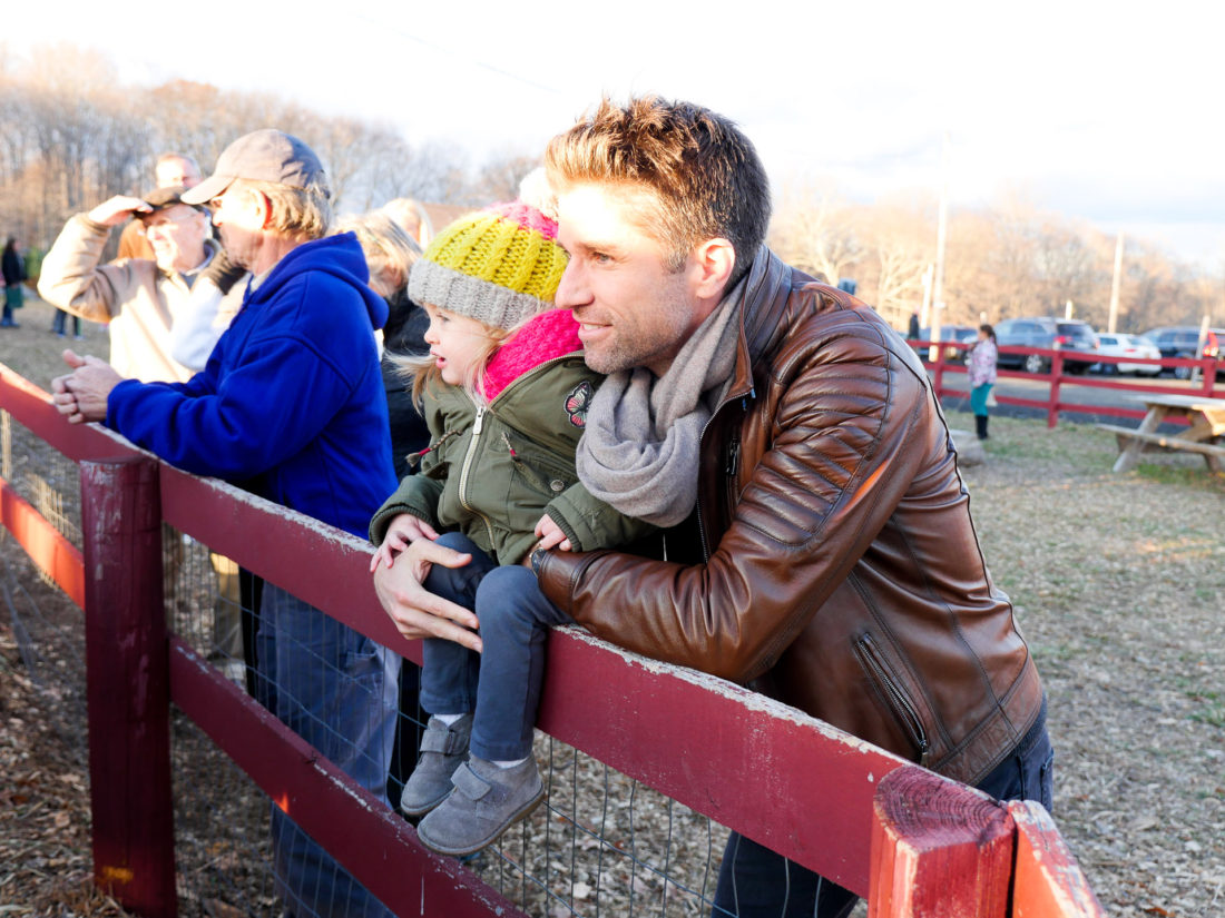 Kyle and Marlowe martino visit with the cows at Maple Row Farm in Connecticut
