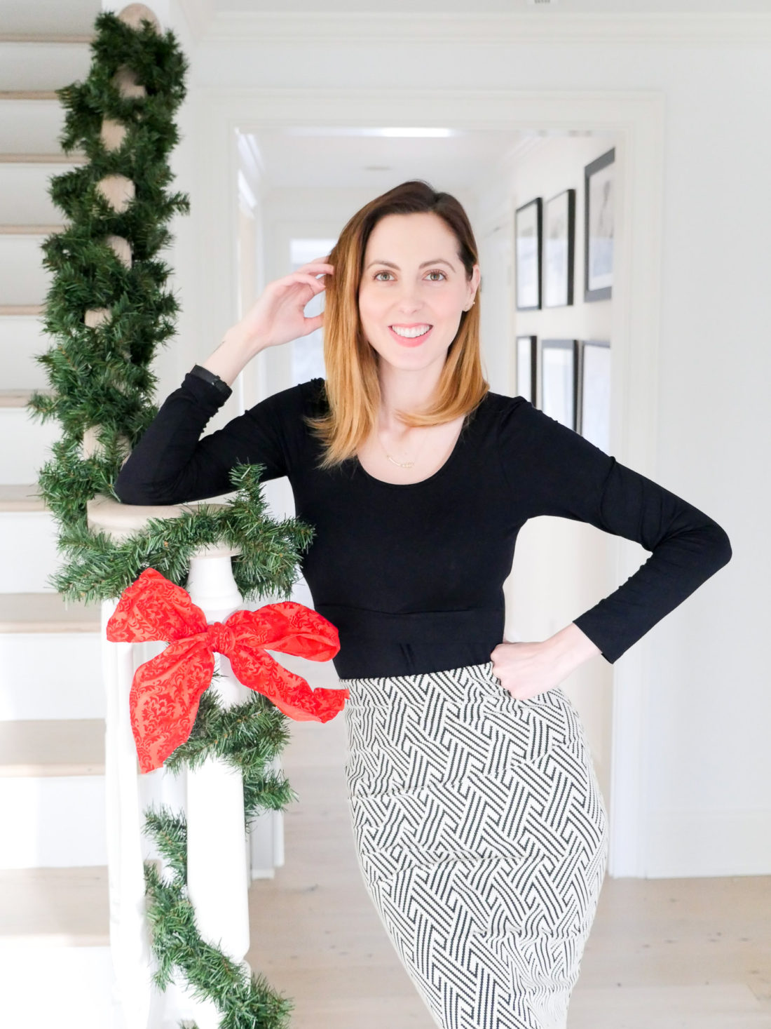 Eva Amurri Martino standing in the foyer of her new Connecticut home at Christmas time