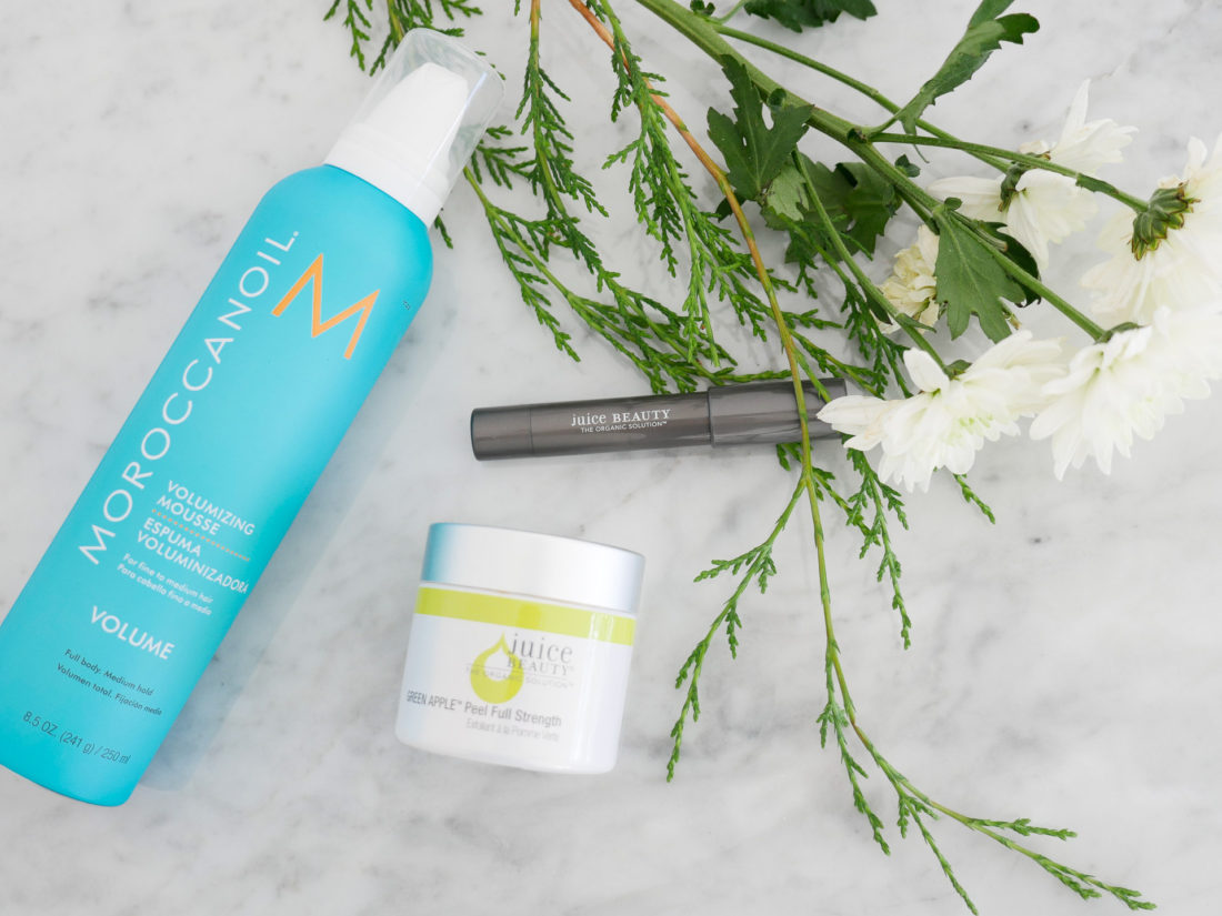 Lifestyle blogger Eva Amurri Martino shows off her monthly beauty picks for december, including Morrocan Oil Volumizing mousse, Juice Beauty Green Apple Peel, and Juice Beauty Luminous Lip Crayon