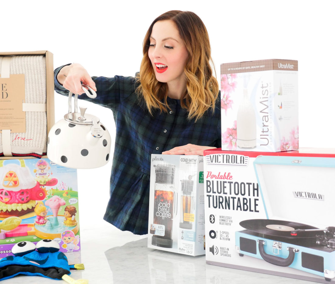 Eva Amurri Martino poses with an array of holiday gifts for friends and family