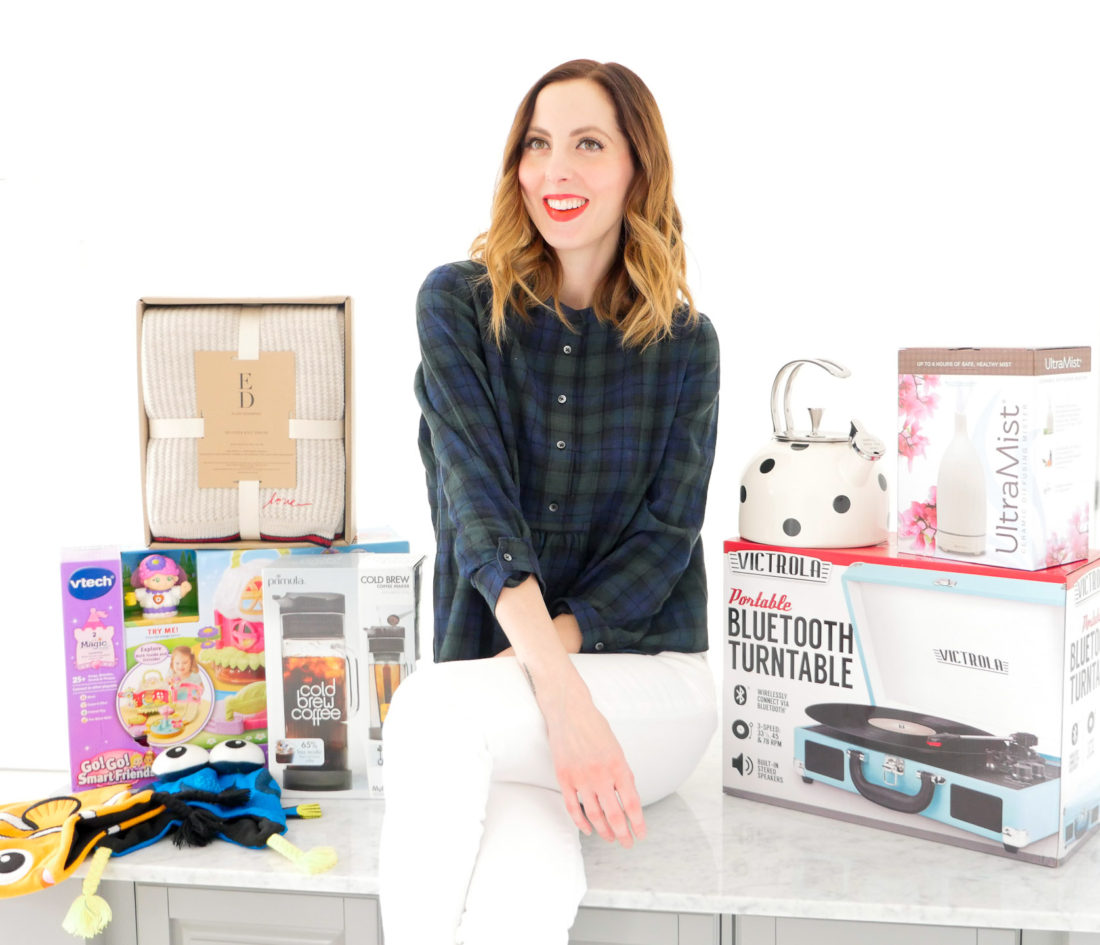 Eva Amurri Martino poses with an array of holiday gifts for her family and friends