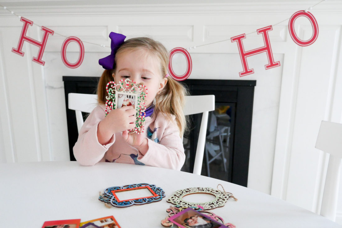 Eva Amurri Martino and two year old daughter Marloweuse plain wooden frames and craft paint to create holiday photo ornaments using the FUJIFILM Instax Mini 70 instant camera