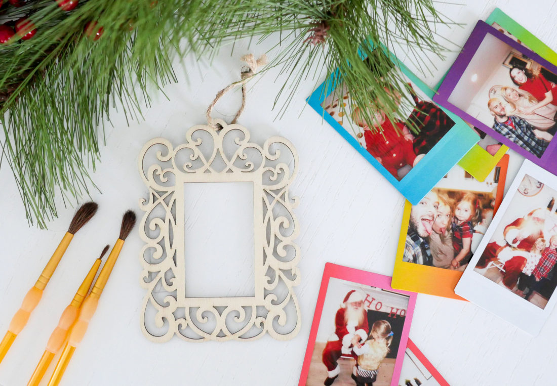 Eva Amurri Martino uses plain wooden frames and craft pain to create holiday photo ornaments using the FUJIFILM Instax Mini 70 instant camera