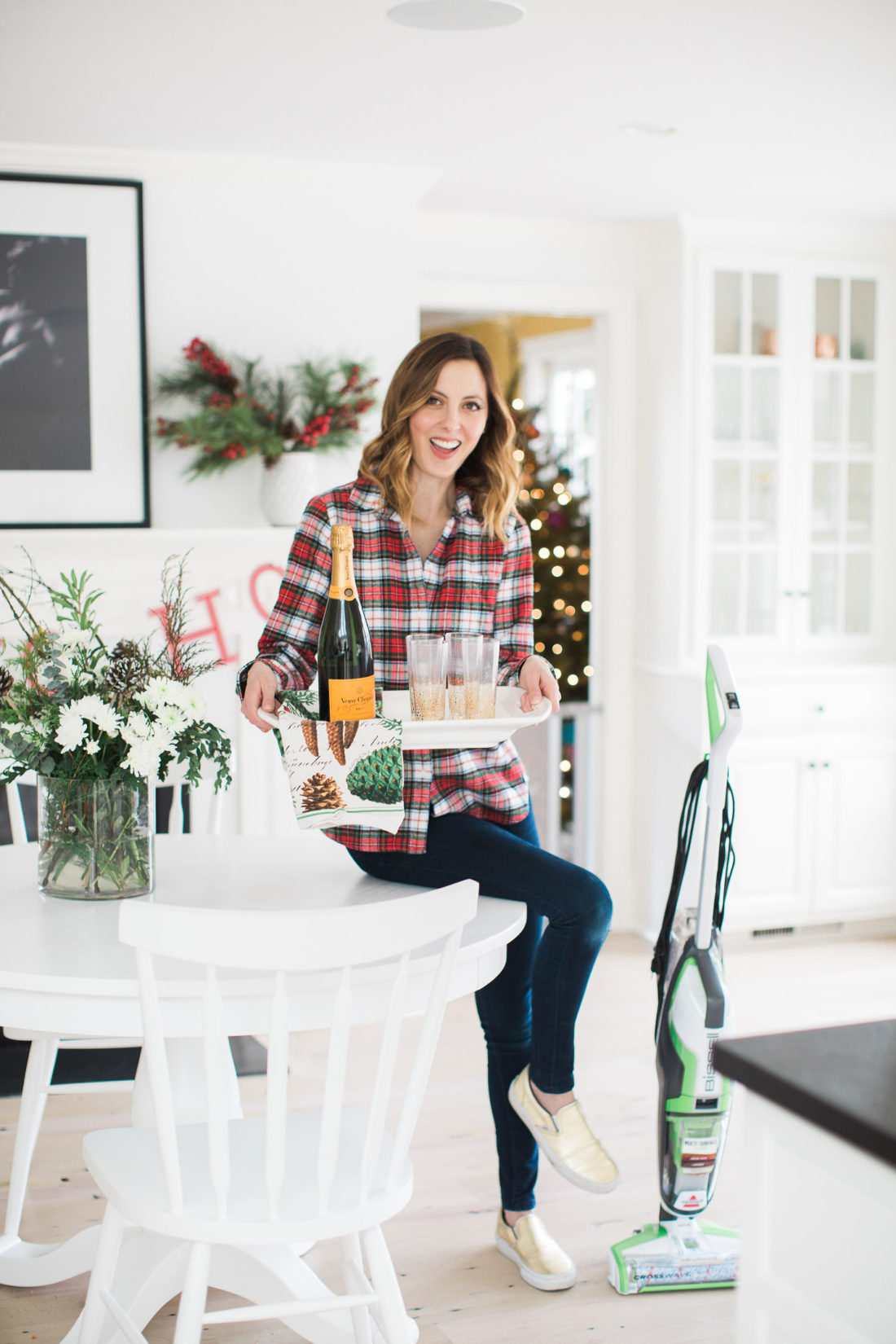 Eva Amurri Martino prepares for a holiday party in her kitchen with a tray of drinks and the bissell crosswave cleaning system