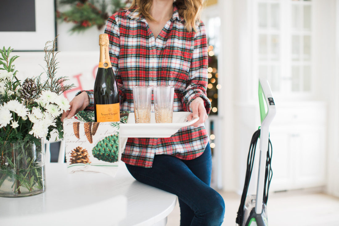 Eva Amurri Martino of lifestyle and motherhood blog Happily Eva After holds a tray of cocktails as she prepares her home for a Holiday party