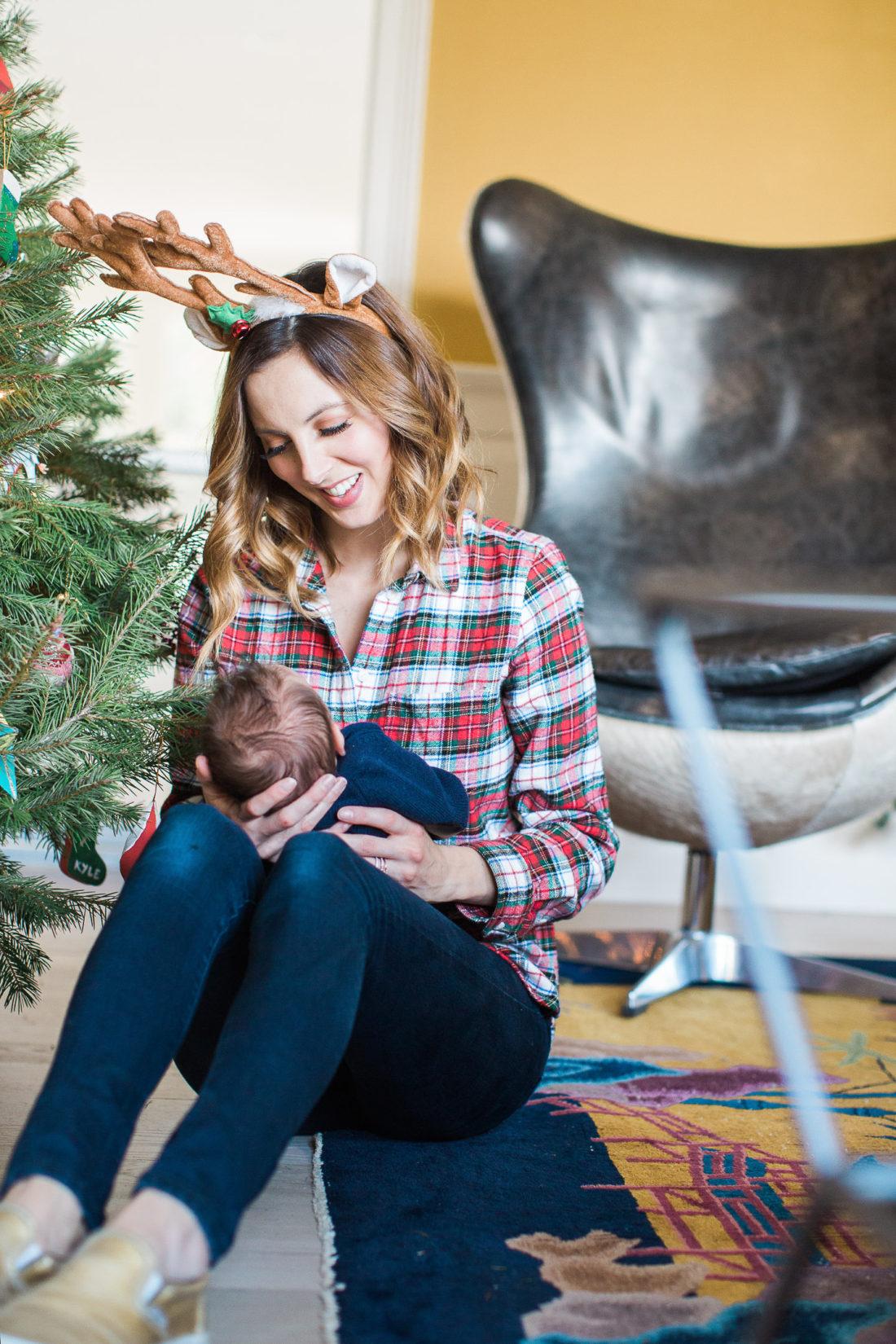 Eva Amurri Martino holds newborn son, Major, next to the Christmas Tree