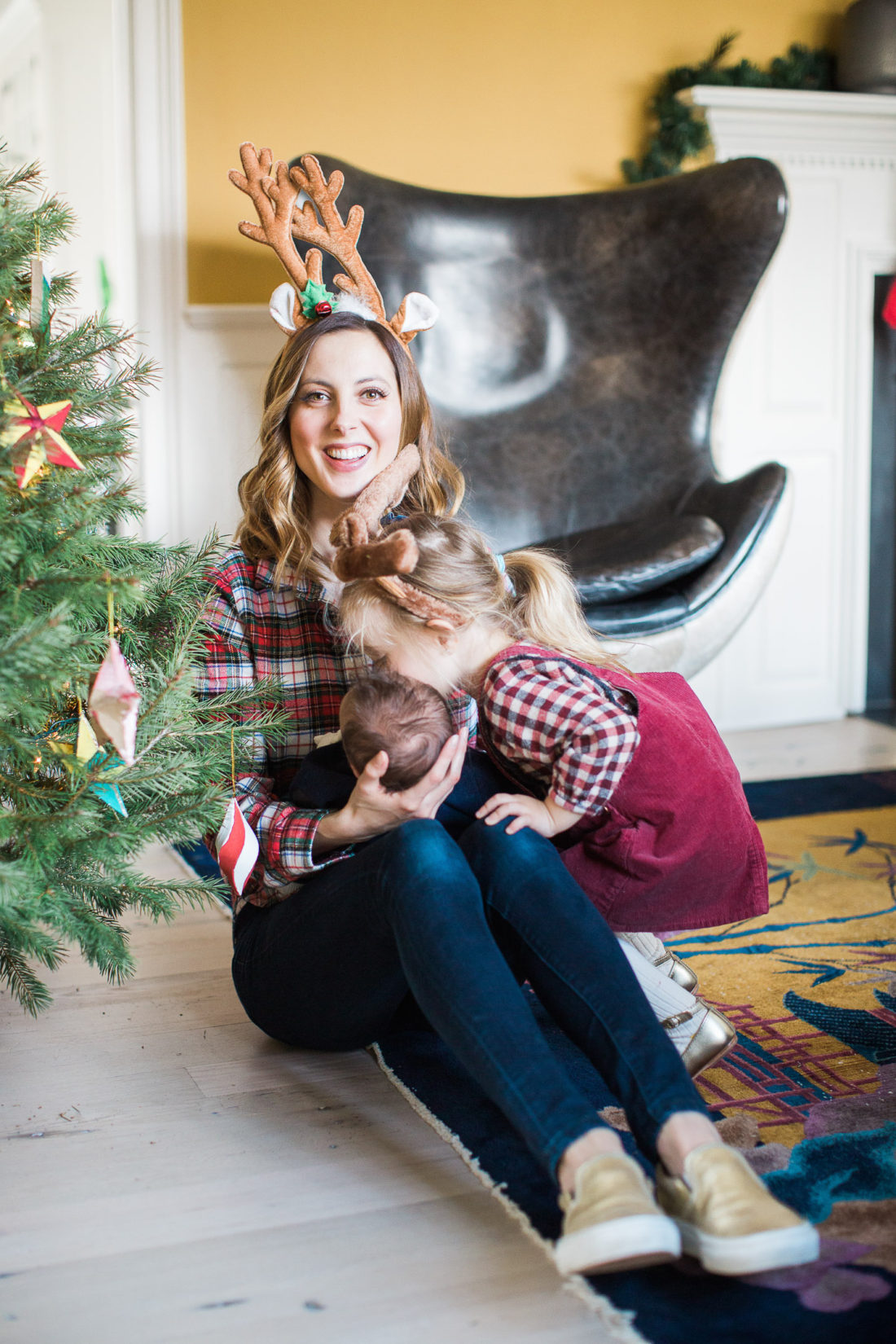 Eva Amurri Martino's toddler daughter Marlowe kisses her baby brother next to the Christmas tree