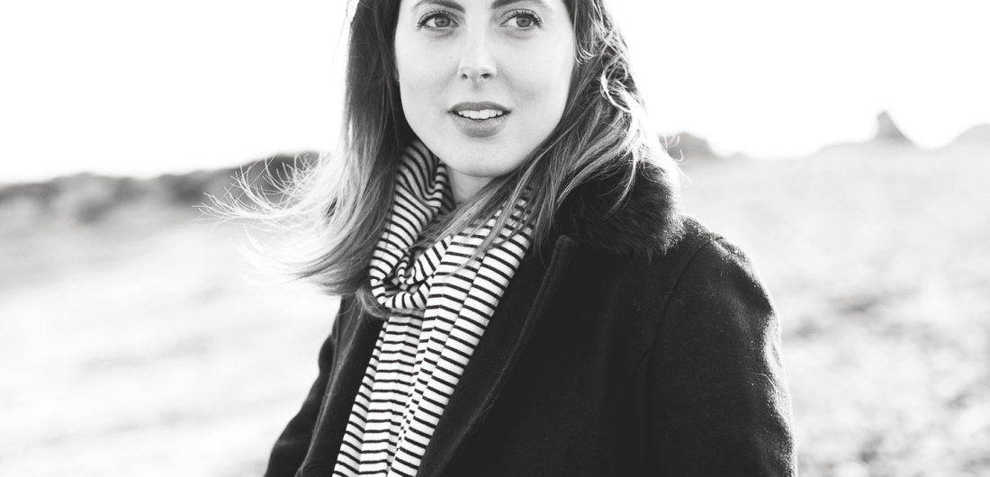 Eva Amurri Martino is bundled up on the sand on the beach in Westport CT in December