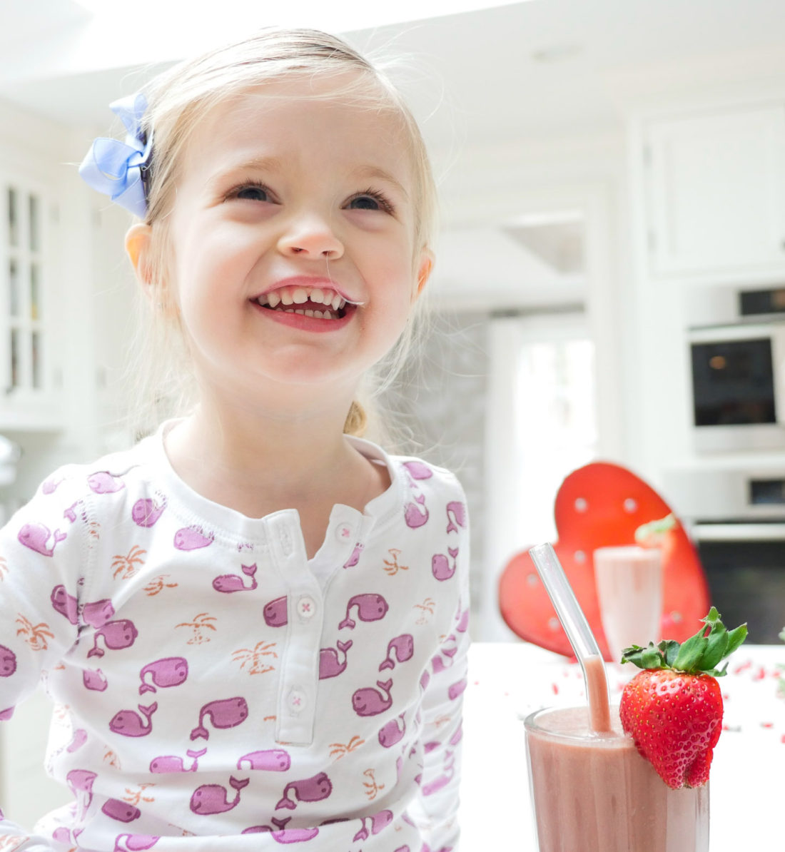 Marlowe Martino smiles and sits beside her chocolate covered strawberry smoothie