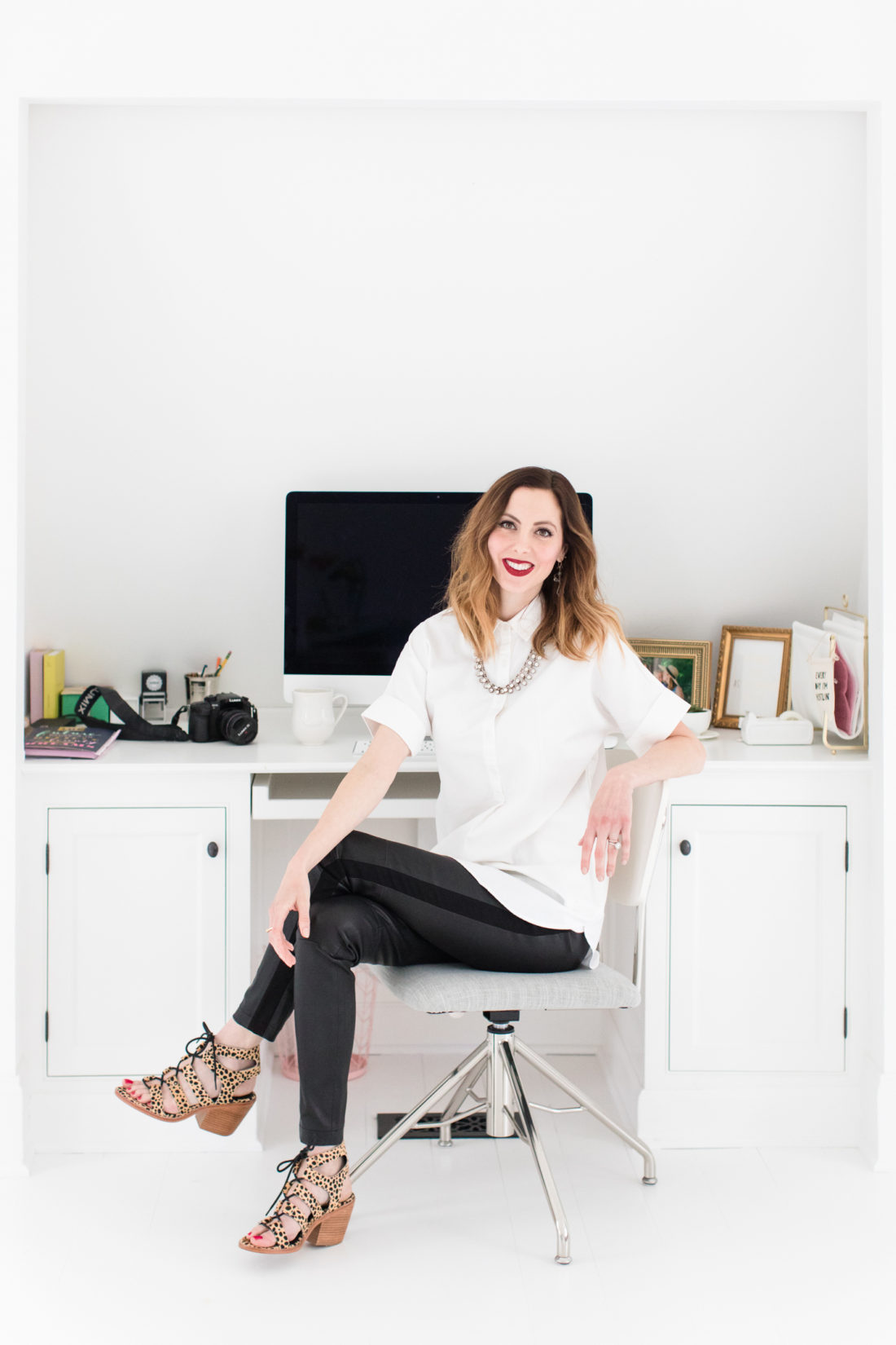 15196a583503f Eva Amurri Martino sits at her desk for blog Happily Eva After, wearing a  white