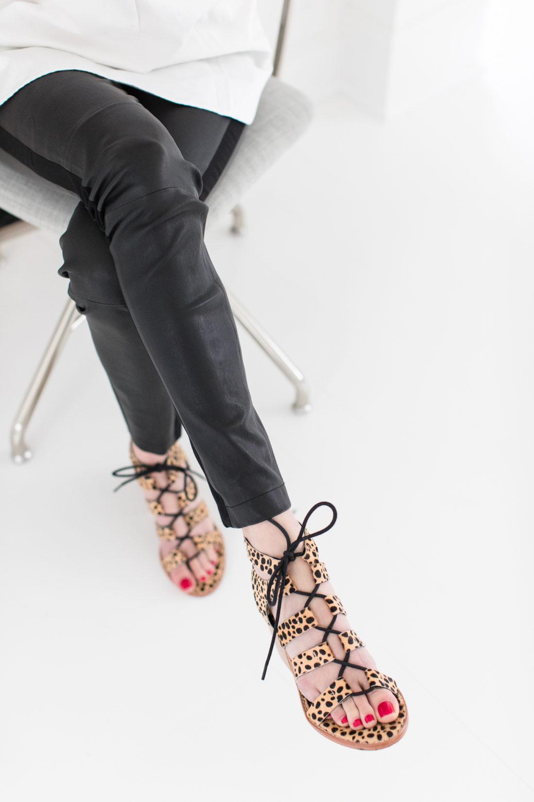 Eva Amurri Martino wears a pair of Sol Sana leopard sandals with black leather leggings