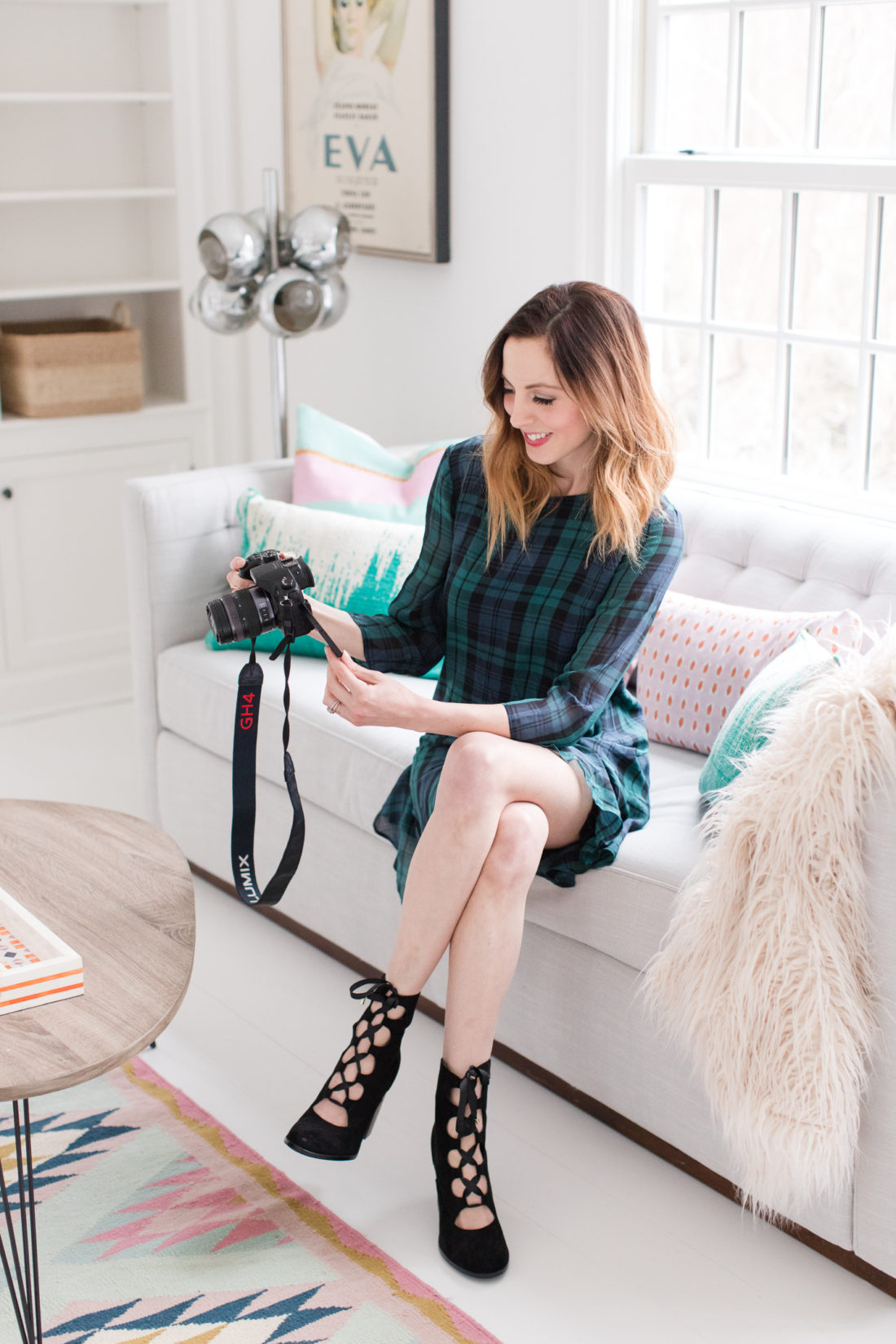 931a71c8319be Eva Amurri Martino wears a plaid shift dress and black boots while she  shoots with her