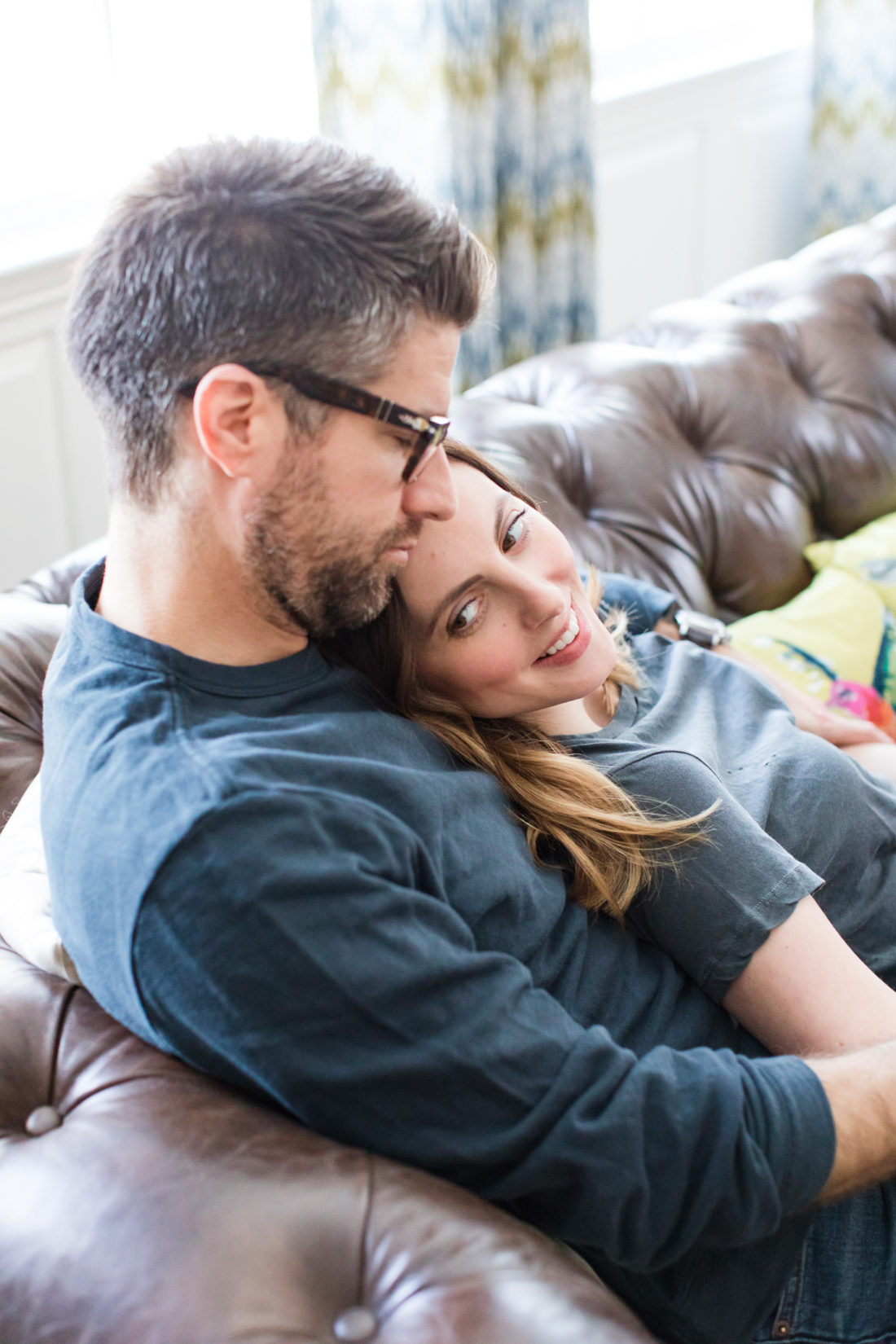 Eva Amurri Martino and Kyle Martino embrace on the couch in their living room in Connecticut